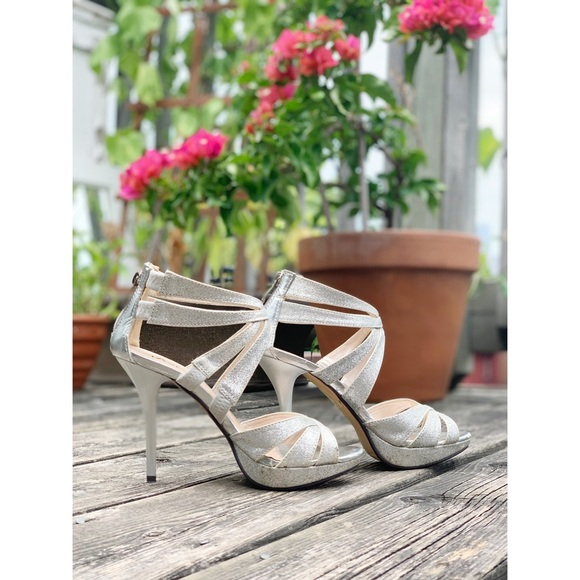 Taxi silver strappy peep toe high heeled shoes